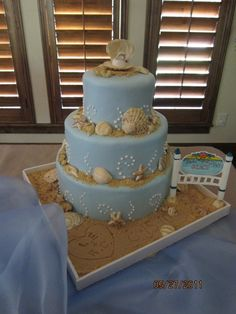 Beach engagement cake by Grace G Cakes