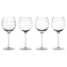 Set of four stemware glasses with etched details.    Product: 4 Piece stemware setConstruction Material: Glass