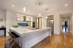 A stunning kitchen is custom-designed with a butler's pantry, steam oven, warming drawer, integrated dishwasher and many metres of bench space, offering the perfect gourmet domain.