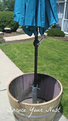 DIY Umbrella Stand Tutorial from Brooke at Spruce Your Nest. thesoutherninstit - Patio Umbrellas - Ideas of Patio Umbrellas - DIY Umbrella Stand Tutorial from Brooke at Spruce Your Nest. Backyard Projects, Outdoor Projects, Backyard Patio, Backyard Landscaping, Outdoor Decor, Diy Patio, Outdoor Living, Backyard Ideas, Luxury Landscaping