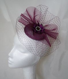 Amethyst Veil & Crinoline Fascinator Order Now from www.indigodaisyweddings.co.uk Specialising in stunning bespoke cocktail fascinators and formal hats in a wide range of colours, perfect for Royal Ascot and The Kentucky Derby. Plus all your wedding floral accessories including shoe clips, bandeau veils,vintage flapper bands, feather and flower fascinators, feather fans, fairy wands, wrist corsages, wedding bouquets & buttonholes. Worldwide Delivery. #wedding #fascinator #indigodaisy #ascot