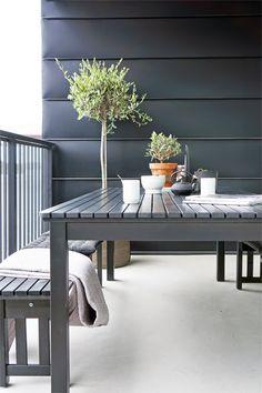 balcony grey outdoor furniture green plants