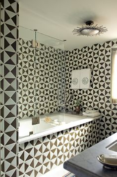 Triangle shaped tile created this great geometric bathroom! by designer Cathy Kincaid