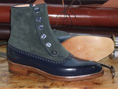 Button-up balmoral boots by Stamp. Green suede and navy calf.