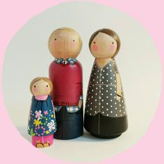 "CUSTOM peg doll family of 3 // personalized 3 1/2"" peg dolls plus child // modern doll house // custom family portrait // wooden toys by PegandPlum on Etsy https://www.etsy.com/listing/197617536/custom-peg-doll-family-of-3-personalized"