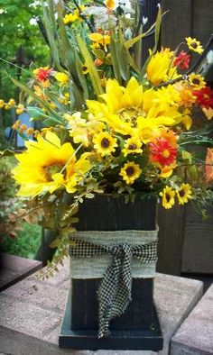Fall flowers in box/light stick $25