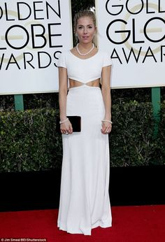 Ripped:The gown featured racy cut-out detail on the torso, showing off Sienna's golden ta...