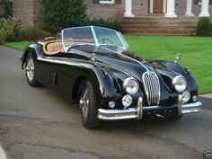 My absolute dream car. All it needs are white-walled tires and I would be set! 1956 Jaguar xk140 roadster.