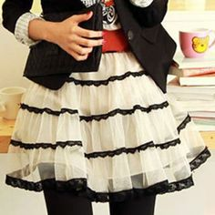 black and white tulle skirt. :) i hope to learn how to do this on my own.