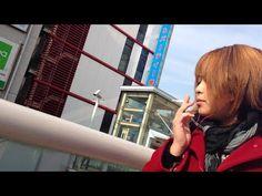 Charming Japanese girl smoking