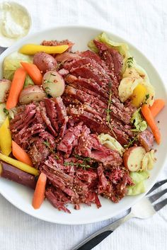 This slow cooker corned beef creates tender, fall-apart chunks of beef thanks to braising in beer and vegetables for an unbelievably easy one-pot dinner.