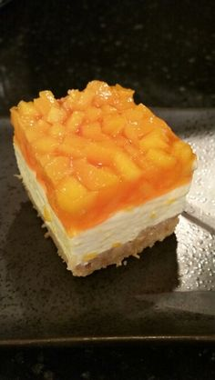 Mango Cream Cheese Squares  Crust Blend 3/4 cup cold butter, 1/2 cup nuts, 1 1/4 cup flour and 1/4 cup brown sugar. Pat into 9x13 pan and bake at 375 for 15 min. Cool  Creme layer Blend 1 box lemon jello with 1 cup hot water, 3/4 cup sugar, 8 oz cream cheese. Fold in 8 oz cool whip. Chill 2 hrs.  Mango layer Dice firm mango and drain. Spread over cream layer. Dissolve 2 boxes of orange jello in 3 cups hot water.  When cool pour over mango. Chill 2 more hours then serve!