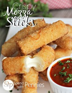 Crispy Mozza Sticks! This easy snack is made with cheese strings and wonton wrappers for an amazing appetizer!