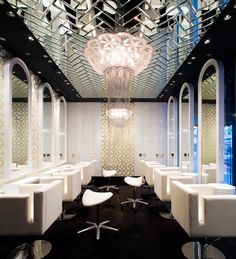 Hair salon inspiration decorated by top designer Blainey North, with a wide Flower of Life chandelier. Salon Lighting, Lighting Design, Lighting Ideas, North Design, Saloon, Architectural Materials, Salon Style, Salon Design, Hospitality Design