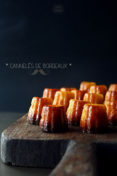 Canelés de Bordeaux is a speciality of Bordeaux, France and traditionally sold in batches of 8 or 16. They are a small pastry with soft custard centre and a dark, thick caramelised crust. (image via Chili & Tonka)