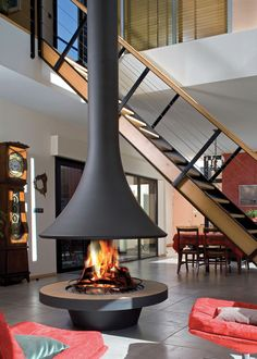 30 Beautiful Modern Fireplaces For Winter Design Ideas Portable heaters installed on the side of the house are also important preparations. For those who already have a home, of course having a fireplace as a h Suspended Fireplace, Hanging Fireplace, Freestanding Fireplace, Home Fireplace, Fireplace Design, Christmas Fireplace, Interior And Exterior, Interior Design, New Homes