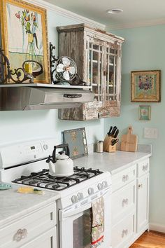 Powder Blue Walls and Distressed Wood Cabinet
