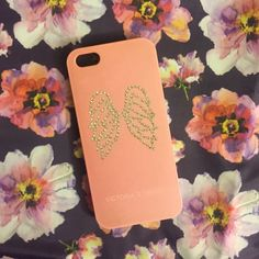An adorable Victoria's Secret IPhone 5/5s case Super cute IPhone 5/5s case from Victoria's Secret. Has angel wings and the brand name on the front. The inside is really soft black velvet. Victoria's Secret Accessories Phone Cases