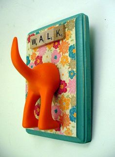 leash holder-- this doesn't have any instructions, but it doesn't look too hard. paint a wood plaque from michaels, modge podge colorful paper to it, add scrabble letters, use a cute hook you already have on hand or sculpt a dog butt from clay
