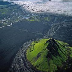 The extinct volcanic cone of Mælifell, near the glacier Myrdalsjökull, south Iceland.    Photographs by Bernhard Edmaier