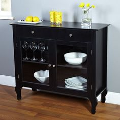 Bring a functional and stylish element to your home decor with this beautiful Layla black buffet. Featuring a classic wood construction with glass-windowed doors, this charming buffet is complete with one adjustable shelf for easy, stylish storage.