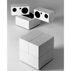 The minimal compact, three-piece cube opens to reveal the speakers, the control panel and the turntable.