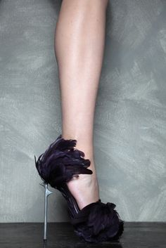I want these! I might be too afraid to wear them because I might mess up the feathers, but I want them nevertheless