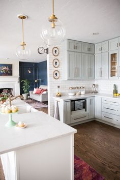 Love this kitchen cabinet color - such a pretty light gray. Blogger shares paint color on her blog as well as details on this DIY kitchen remodel! #kitchen #homedecor #kitchenremodel