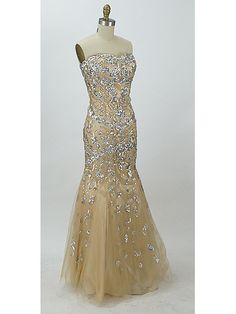 Breathtaking mermaid style evening gown/prom dress in a pale gold/champagne charmeuse satin overlaid by champagne tulle embellished with shimmery silver sequins, beading and rhinestones.
