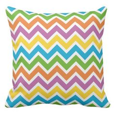 A pillow showing a colorful chevron pattern. This beautiful pillow will add that special bit of vibrant color to your homes stylish decoration.
