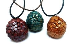 These are the famous dragon eggs of Daenerys Targaryen.There are totally handmade by me with polymer clay.You can choose among the three options red,green and golden,each egg has approximately 2,5cm length.In addition you can choose your preferable length of cord among 18,20,22,24 inches.The egg is hanging from black cotton cord with silver plated metal findings(clasp etc.).I hope you like it!! :)