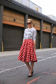 Skirts that fall below the knee but above the ankle are often considered a don't for women who aren't long and lean, but if the proportions are right, they can add a striking, often retro appeal to any look. Midi skirts with a slight flare can be super-flattering on smaller girls, so long as they're paired with a dainty pair of heels and tucked-in or slightly shrunken tops, so as not to get swallowed up in fabric