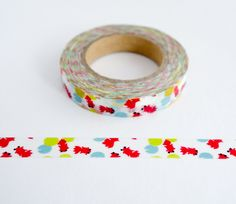 Single roll of thin washi masking tape with red goldfish pattern. Great for travel journals, scrapbooking, gift wrapping, decorating cards and envelopes and more! Add a little dash of cuteness to any