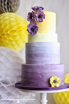 Ombre striped cake with yellow and purple Anemones