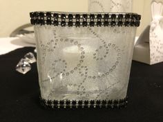 Center Pieces:  Placing on each table three candle holders using a variety of different shape glass.  Short square, goblet and tall glass.  Covered with glittered chiffon fabric and rhinestone trim.