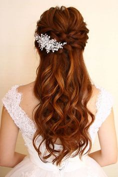 Your half up half down hair doesn't need to be symmetrical. Add a glittering clip to just one side of your hair and feel free to build up the braids on the other side. This gorgeous, vintage-style design is by Christine Chia. #hair #weddinghair #hairstyles #hairstylesforwomen #halfuphalfdownhair #wedding #hairgoals #hairfashion #weddingideas