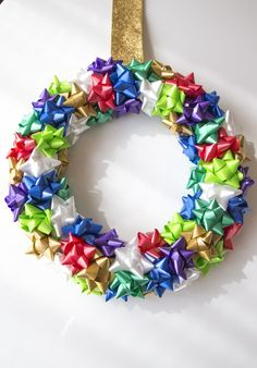 For this project you will need 14 inch foam wreath form, around 100 bows (allowing for some messed up bows inside of your packages), hot glue and wide ribbon. Christmas Bows, Christmas Items, Christmas Lights, Christmas Crafts, Xmas, Gift Bows, Wreath Tutorial, Outdoor Christmas Decorations, Bow Wreath