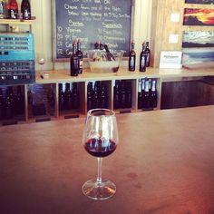 A single glass of red at Malibu Wines