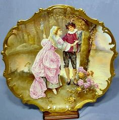 Limoges Wall Plaque Decorated with a Young Man & Woman wearing fancy clothing of royalty. They are in an outdoor setting with trees, flowers and lake or river. The female is carving initials into a tree with the mans dagger Vintage Plates, Vintage China, Fine Porcelain, Porcelain Ceramics, Victorian Art, Glazes For Pottery, Ceramic Painting, Wall Plaques, Art Decor