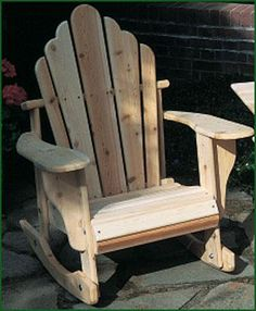 "Ossipee Rocker -  Rocker, Natural Cedar. Crafted from Northern White Cedar, they feature extra-wide arms and comfortable contoured seats which do not slope back as much as our classic Adironack chairs - making it easier to get in and out of.  Also available in White and Green.  Cushions sold separately.Shipped kit.  40"" H, 33"" W, 33"" D."