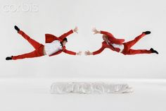Two men in red suits falling