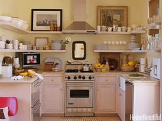 This kitchen may be small but it makes good use of space thanks to smart storage solutions.