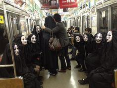 Spotted on the train in Japan, a bunch of No Face. Halloween 2012 in Japan. Hayao Miyazaki would be proud. (ともだちが難波でカオナシこすぷれしてるらしい。15人で。たまらん。カオナシ軍団みつけたらそれKANBIです。)