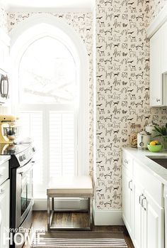 A small kitchen has plenty of personality thanks to Best in Show wallpaper from Thibaut.  Interior design by Nancy Serafini, photography by Michael J. Lee  Individual Style | New England Home Magazine