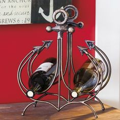 Nautical Wine Bottle Racks: http://www.completely-coastal.com/2016/03/wine-bottle-racks-coastal-nautical.html From anchor to boat!