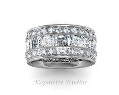 Custom eternity wedding band with princess cut diamonds and pave. Set in platinum.  Www.kjohnsonjewelry.com