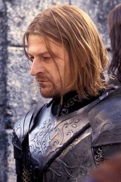 Boromir -- notice the engraving of the White Tree of Gondor on his armor
