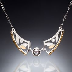 Mixed Metal Curve Necklace by Susan Kinzig. Necklace handcrafted with matte sterling silver, 22k gold bi-metal, pyrite, gold hematite, and freshwater black and white pearls.