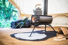 Designed with a larger flue and sporting a glass window, this portable woodstove is perfect for chilly camping nights or heating up any small living space.