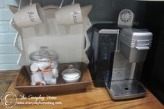 cute idea hand cups his/hers by the coffee machine. With some cream and some sugar :)